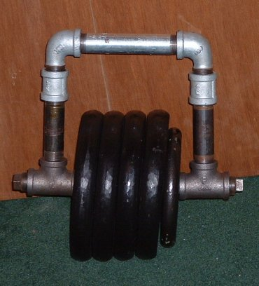 Homemade kettlebell with tubing and weight plates
